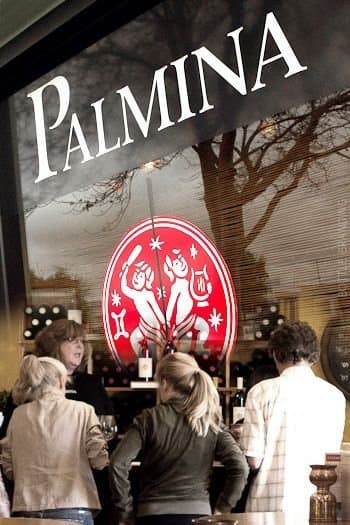 people enjoying the Palmina Winery tasting room as an example of life in the Santa Ynez Valley.